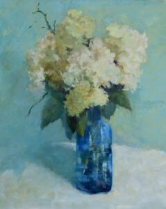 white hydrangea in blue vase