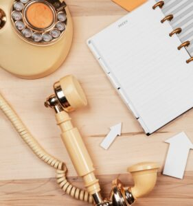 vintage phone and note pad